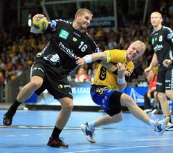 Henrik Knudsen working in defence in Kielces match against the Rhein Neckar Löwen.