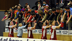 The players of Oltchim celebrate with their fans after the victory in Vienna.