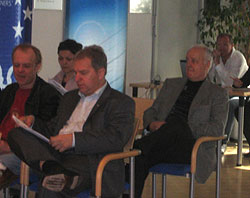Gerald Berger (in the middle) and other club officials waiting for the draw