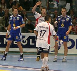 Solberg (in blue on the left) defending next to Hagen